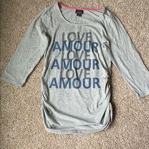 Size large love amour maternity shirt.  3/4 sleeve